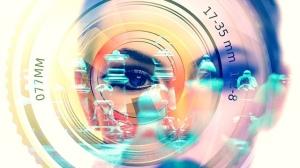 Eye behind camera lens chess
