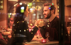Couple holding hands at table romance