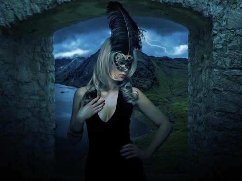 Blonde in black feather mask
