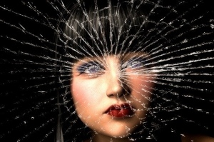 woman's face shattered glass