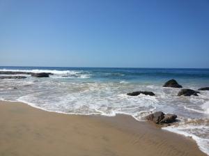 beach ocean sand surf waves rocks