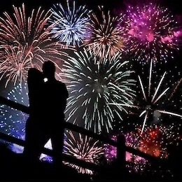couple kiss fireworks