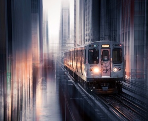 train downtown city buildings