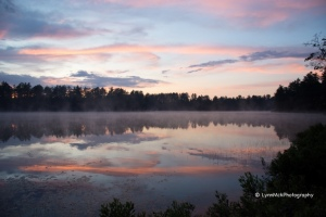Grey clouds reflection lake water