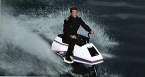 Roger Moore as James Bond on jet ski