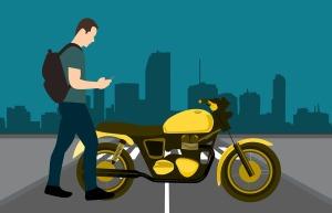 man motorcycle city