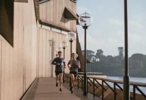 Couple jogging lake